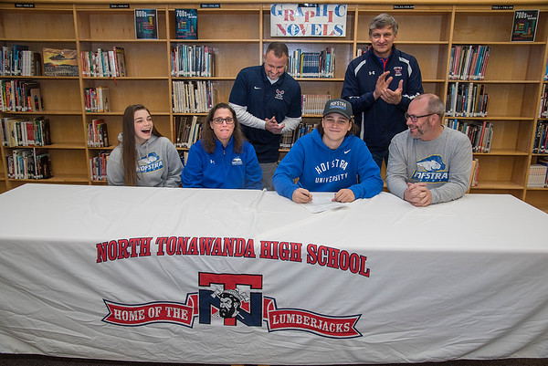 James Neiss/staff photographer <br /> North Tonawanda, NY - The Lumberjacks' Jaxon Hummel signs his D-I National Letter of Intent to play golf for Hofstra University. Jaxon was joined by his sister Jordan, mother Cathy and father Todd. Behind are Athletic Director Matt Cook and Coach Alan Zbytek.