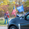 201014 Singing Trump 1<br /> James Neiss/staff photographer <br /> Niagara Falls, NY - Vincent Crampton has been dressing up as Donald Trump and singing his praise to passing traffic on Porter Road.