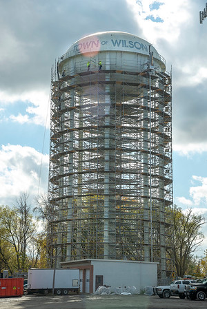 201028 Enterprise<br /> James Neiss/staff photographer <br /> Wilson, NY - Workers finnish off the top level of scaffolding around the Wilson water tower that is being repainted. The project is expected to last well into next year as winter approaches.