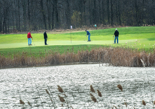 201120 Enterprise 3<br /> James Neiss/staff photographer <br /> Lewiston, NY - Golfers enjoy the balmy late November weather for a round of golf at the Seneca Hickory Stick Golf Course.