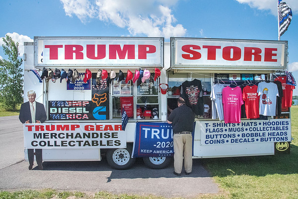 "200720 Trump Trailer 2 <br /> James Neiss/staff photographer <br /> Niagara Falls, NY - A customer buys Trump goods at The Trump Trailer, that made a stop at Gratwick Riverside Park on Monday. Tom the proprietor, from Buffalo, said he plans setting up again on Tuesday for those looking to get some Trump memorabilia.  Those wishing to find out where it will be next can do so by searching facebook at <a href=""https://www.facebook.com/Trump-Trailer-114082267029014/"">https://www.facebook.com/Trump-Trailer-114082267029014/</a>."