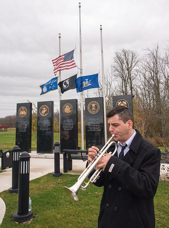 201111 Town Vets Day 3<br /> James Neiss/staff photographer <br /> Town of Niagara, NY - Musician Joe Pasquantino played the Star Spangled Banner and Taps during Veterans Day service at the Town of Niagara Veterans Park.