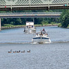 200724 Enterprise 1<br /> James Neiss/staff photographer <br /> Lockport, NY - Boaters traveling to destinations unknown pass under the Adam Street bridge on the Erie Canal in Lockport.