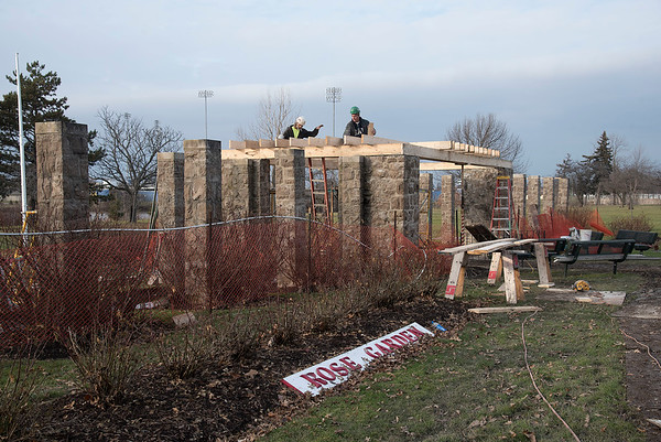 James Neiss/staff photographer <br /> Niagara Falls, NY - Carpenters Kenny Tower and Bryan Virtuoso with Scrufari Construction install new roof joyces on the old Rose Garden as part of a reconstruction project at Hyde Park.