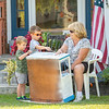 200923 Enterprise 7<br /> James Neiss/staff photographer <br /> Pendleton, NY - Parker, 4 and Connor Nolan, 6 help their grandmother Diane Preston Paint an antique bookcase in front of her Aiken Road home.