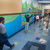 200910 NF First Day 1 <br /> James Neiss/staff photographer <br /> Niagara Falls, NY - Kindergartners at Hyde Park Elementary learn how to social distance by stopping at marks on the floor as they walk… or jump, on the first day of school in Niagara Falls.