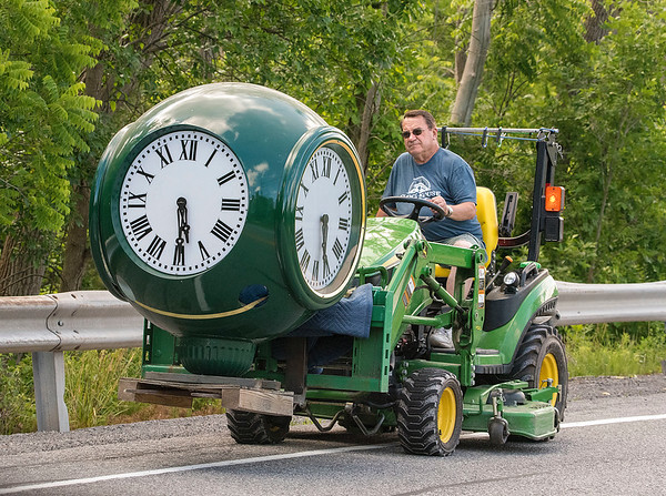200701 LKPT Enterprise 1<br /> James Neiss/staff photographer <br /> Lockport, NY - Time Travel - Horologist (clock maker) Chuck Roeser was spotted on East Canal Road moving a giant street clock face from his warehouse to his clock shop. Roeser, owner of Essence Of Time, said the clock, made in Michigan, is being assembled, tested, then shipped to a client in Texas.