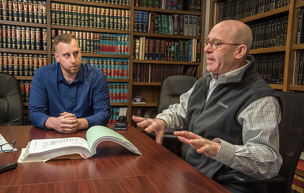 James Neiss/staff photographer <br /> Kenmore, NY - Former Lockport Police Officer Mark Wallace and his attorney Paul D. Weiss, talk about Wallace's lawsuit.