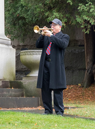 201111 LKPT Vets Day 3<br /> James Neiss/staff photographer <br /> Lockport, NY - Byron Dibble plays Taps during the Lockport Veterans Day observance at Cold Springs Cemetery.