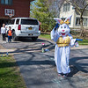 200406 Easter Bunny 2<br /> James Neiss/staff photographer <br /> Niagara Falls, NY - The Easter Bunny, a really good friend of Gina Streck of Niagara Falls, tosses candy from a safe distance during a visit to Gia and Paulie Wrobel at their 58th Street home, Streck and the bunny made 30 stops on Monday and plans to visit Lewiston and Youngstown in the coming days.