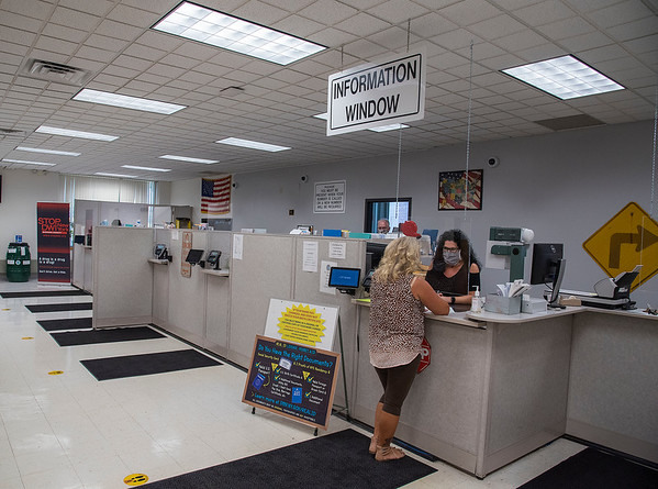 200629 NF DMV 1<br /> James Neiss/staff photographer <br /> Niagara Falls, NY - Now open on an appointment only basis, the staff at the Niagara Falls DMV get ready for customers on Monday.