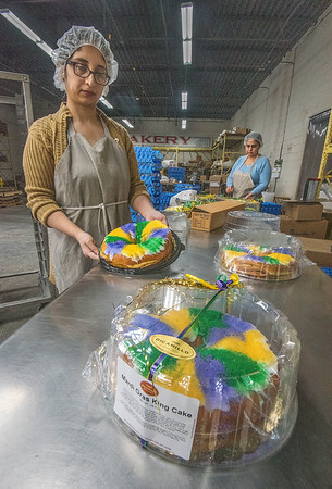 James Neiss/staff photographer <br /> Niagara Falls, NY - Sonia Mian decorates packages of Mardi Gras King Cake just in time for Ash Wednesday.