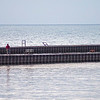 James Neiss/staff photographer <br /> Wilson, NY - A bicyclist takes a ride on the Wilson Pier as a fisherman tries his luck.