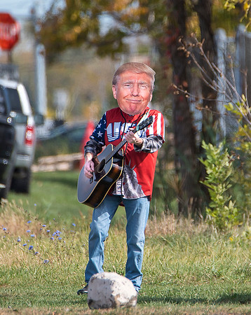 201014 Singing Trump 3<br /> James Neiss/staff photographer <br /> Niagara Falls, NY - Vincent Crampton has been dressing up as Donald Trump and singing his praise to passing traffic on Porter Road.