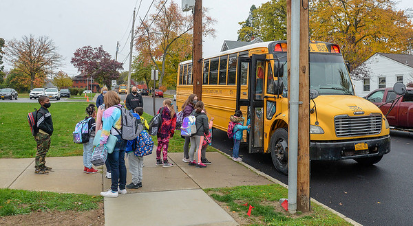 201019 Maple Ave 1<br /> James Neiss/staff photographer <br /> Niagara Falls, NY - Maple Avenue Elementary students head home after returning to school on Monday after a few weeks COVID hiatus.