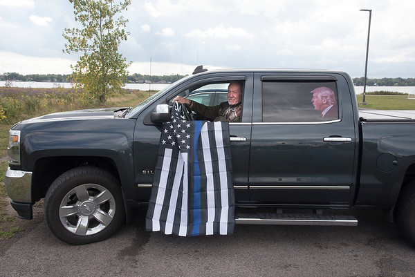 201002 Trump Trailer 3<br /> James Neiss/staff photographer <br /> Niagara Falls, NY - Retired Niagara Falls Police Detective Jim Lincoln stopped by the Trump trailer to pick up a Blue Lives Matter flag. He already had Trump riding in his back seat.