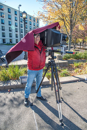 201104 Enterprise 3<br /> James Neiss/staff photographer <br /> Niagara Falls, NY - Rochester based photographer Edgar Praus sets up his 8x10 view camera for a shot along Old Falls Street on Wednesday. Praus, said he was working on a photo series featuring Niagara Falls, NY.