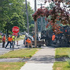 200630 LKPT Enterprise 1   <br /> James Neiss/staff photographer <br /> Lockport, NY - Road crews pave a section of road on Locust Street on Tuesday.