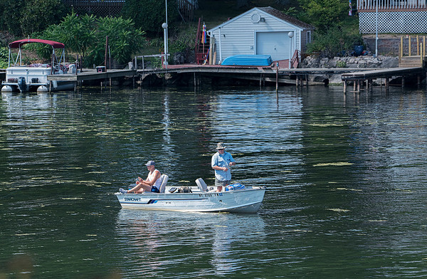 200824 Enterprise 2<br /> James Neiss/staff photographer <br /> Wilson, NY - Two men seemed to be enjoying the morning air fishing in Wilson Harbor.