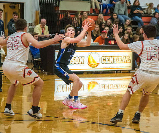 James Neiss/staff photographer <br /> Wilson, NY - Newfane #3 Josh Everett looks to pass during basketball game action against Wilson.