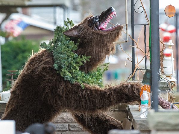 201216 Enterprise 1<br /> James Neiss/staff photographer <br /> Niagara Falls - Representing - There is nothing like spreading a little holiday cheer by decorating the killer werewolf on your front porch like this Lewiston Road resident.