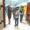 200908 LKPT Back to School 3<br /> James Neiss/staff photographer <br /> Lockport, NY - North Park Junior High Principal Bernadette Smith directs a student to a classroom during a change class on the first day of school.