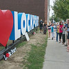"200902 Love Lockport 1<br /> James Neiss/staff photographer <br /> Lockport, NY - Ellen Martin, first in line, was joined by other members of The Lockport Public Arts Council and friends in front of the finished art installation ""Love Lockport,"" on Main Street. The project was dedicated to the memory of Jenny Martin.<br /> <br /> Description:<br /> 'Love Lockport' sign / public art installation dedication rescheduled<br /> The Lockport Public Arts Council will formally dedicate a new downtown landmark, the ""Love Lockport"" art installation at 60 Main St., at 5:30 p.m. Sept. 2.<br /> Contact Ellen Martin, 443-418-8720 or 716-439-1517.<br /> ASSIGNED BY  MILES."