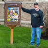 "200518 Take & Leave Enterprise 3<br /> James Neiss/staff photographer <br /> Niagara Falls, NY - Rick Penale of Lewiston was spotted trighting some screws in a ""Take What You Need, Leave What You Can"" box outside of St. Peters on Rainbow Boulevard. Rick and wife Rene built and keep the box stock, he said.  ""I saw one of these on the internet and my wife and I decided to find somewhere to put one."" When complimented on his giving spirit he said, ""A couple cans at a time, doing the lord's work."""
