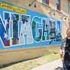 200805 Mural 2<br /> James Neiss/staff photographer <br /> Niagara Falls, NY - Artist Paul Clifton stands with the mural he painted on the side of the Wine On Third building at the corner of Third Street and Ferry Avenue. Members of the DNFBA and city officials officially unveiled the mural on Wednesday.
