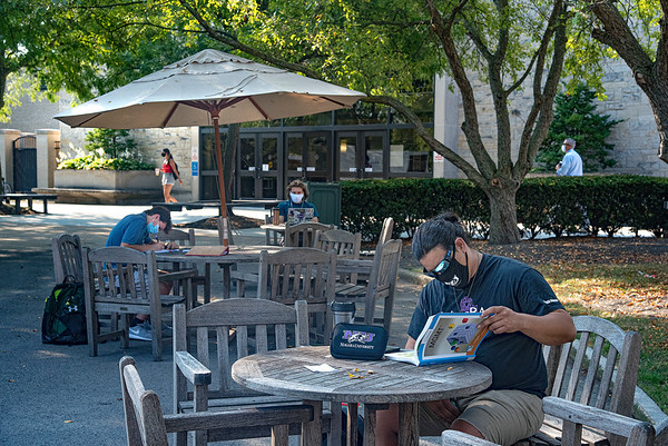 200824 NU First Day 1<br /> James Neiss/staff photographer <br /> Lewiston, NY - Account major Heriberto Acevedo of Niagara Falls, right, hit the books early on the first day of the fall semester at Niagara University.