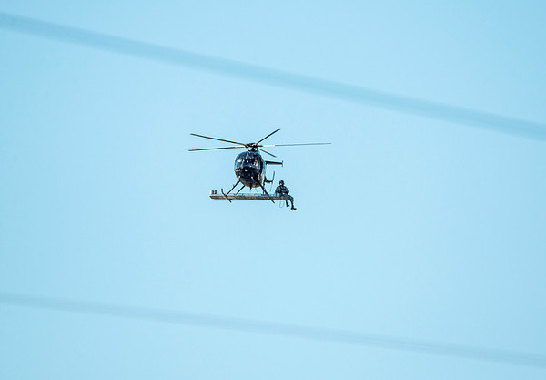 201008 Enterprise 2B<br /> James Neiss/staff photographer <br /> Niagara Falls, NY - What Does Your Office Desk Look LIke? Helicopter linemen head to a high voltage transmission tower to work on some upgrades in the Town of Niagara.