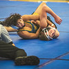 James Neiss/staff photographer <br /> Grand Island, NY - Wrestling in the 99 lb. weight class Niagara Falls Jaden Crumpler tries to pin Nik Massaro.