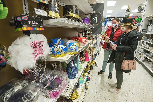 201230 New Years 2<br /> James Neiss/staff photographer <br /> Niagara Falls - Denise Gleason and daughter Meaghan, 20, check out the 2021 New Years items at Party City.