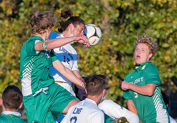 201016 LewPort Lockport 4<br /> James Neiss/staff photographer <br /> Lewiston, NY - Lockport soccer player #12Trent Smith uses his head to smash the ball during game action against Lew-Port.