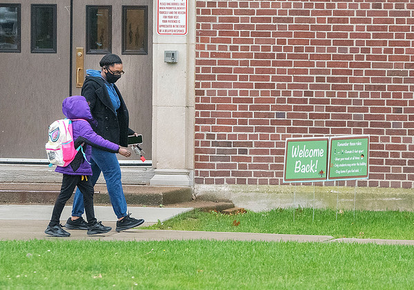 201019 Maple Ave 2<br /> James Neiss/staff photographer <br /> Niagara Falls, NY - Maple Avenue Elementary students head home after returning to school on Monday after a few weeks COVID hiatus.
