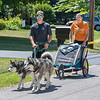 200730 Enterprise 2<br /> James Neiss/staff photographer <br /> Youngstown, NY - Strolling In Stride - Robert and Kerstin Barns keep in step with their two dogs as they walk the streets of Youngstown with their two children Eloise, 1 and Maisie, 4 months, in the stroller.