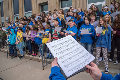 James Neiss/staff photographer  Lockport, NY - North Park Junior High School students sing their Alma Mater after forming a giant number 80 to celebrate the schools 80th birthday.