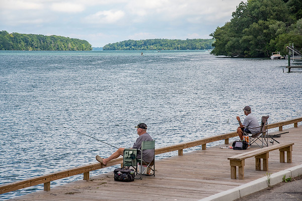 200724 Enterprise 4<br /> James Neiss/staff photographer <br /> Lewiston, NY - It was a fine day for fishing on the Niagara River at Lewiston Landing on Friday. The rest of the weekend is shaping up to be so too.