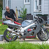 200724 Enterprise 3<br /> James Neiss/staff photographer <br /> Nigara Falls, NY - Lester Cook shines up his new Suzuki 750 at his ChestNut Street home in anticipation of great riding weather this weekend in Niagara County.