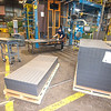 200313 Confer Plastics 3<br /> James Neiss/staff photographer <br /> North Tonawanda, NY - Alex Suarez, a machine operator at Confer Plastics, works on hot tub panels as they come out of the plastic mold.