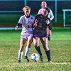 201020 Roy Hart Wilson 2<br /> James Neiss/staff photographer <br /> Middleport, NY - Wilson #3 Madelaine Schultz goes head to head with Roy-Hart #2 Grace Parker during soccer game action at Roy-Hart.