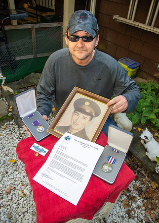 201016 Veteran Honors 1 James Neiss/staff photographer  Niagara Falls, NY - Thomas Martell has been trying for years to get his veteran uncle, Peter J. Dodd, a little local recognition for sacrificing his life in the Korean War by sending letters to local government officials and several Presidents of the United States. After all these years a response came from Niagara Falls Mayor Robert Restino in a letter addressed to his mother Elaine Martell, Peter Dodd's sister, honoring her brother for his sacrifice.