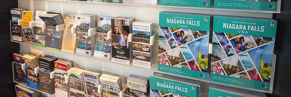 201029 Local Tourism 3<br /> James Neiss/staff photographer <br /> Niagara Falls, NY - Attraction brochures line the shelves at the Niagara Falls Visitors Center. Tourism officials are already at work making plans for the next tourist season.