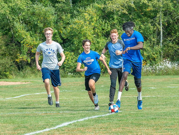 200924 Newfane Sports 1<br /> James Neiss/staff photographer <br /> Newfane, NY - Newfane soccer player Deuce Capen handles the ball as teammates, from left, Max Czekal, Connor Gunby and Brady Harrington pursue during practice.