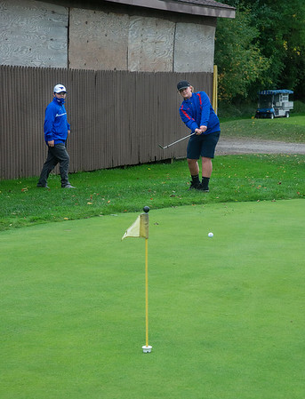200929 Wilson Golf 1<br /> James Neiss/staff photographer <br /> Lockport, NY - Wilson varsity golfers Brody Fry, left and Ryleigh Culver practice at Willowbrook Golf Course.
