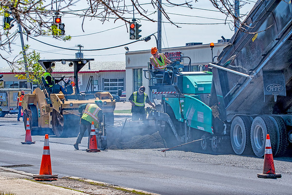 200520 Enterprise E<br /> James Neiss/staff photographer <br /> Town of Niagara, NY - Paving crews were hard at work on Military Road putting down fresh blacktop.