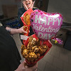 James Neiss/staff photographer <br /> Niagara Falls, NY - What woman wouldn't want a chicken wing or chicken finger bouquet for Valentines from Mr. Ventry's Pizzeria and Restaurant. They apparently make employee Carolyn Sobol giddy and swoon.