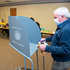 201103 Election Day 1<br /> James Neiss/staff photographer <br /> Lockport, NY - Election inspector Tom Smith disinfects a voting booth at the Lockport Library polling site.