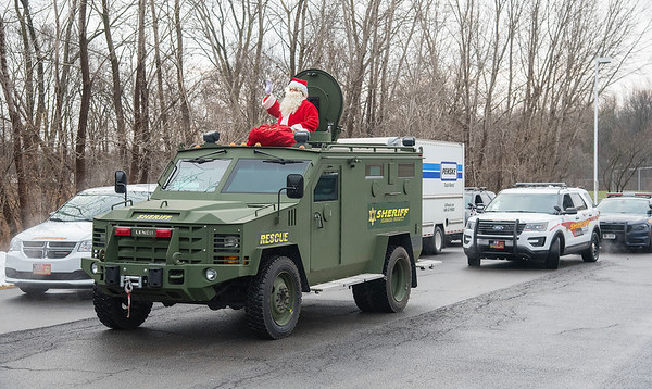201221 Sheriff Parade 2<br /> James Neiss/staff photographer <br /> Lockport - The Niagara County Sheriff's Office gave veterans and their children a Christmas parade, partnering with SERV Niagara and State Senator Rob Ortt. The start of the parade was Santa, aka: Pete Robinson with NYS Courts and A Hand Up Inc. Peanut Butter & Jelly Drive.