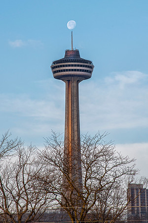 201203 Moon Enterprise<br /> James Neiss/staff photographer <br /> Niagara Falls, NY - Some days everything seems to line up, just like today with the moon over the Skylon Tower in Niagara Falls Ontario.